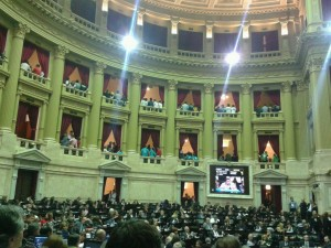 Onlookers in the Argentinean Chamber of Deputies turn their backs during speeches by opposition congressman.