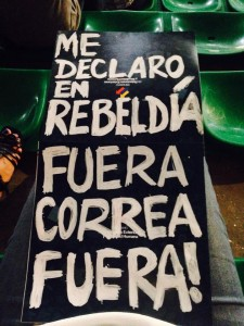 Ecuadorian immigrants brought protest signs to President Correa's Citizen Link recording in Milan, Italy.