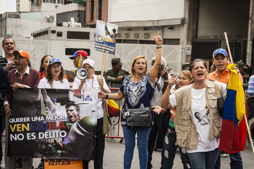 Protesters supporting López assemble outside the Palace of Justice every time the leader is brought to a hearing