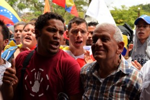 Robert Redman's father takes part in a demonstration in Caracas months after his son's murder.