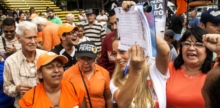 The wife of opposition leader Leopoldo López signs a petition calling for a constituent assembly on Saturday