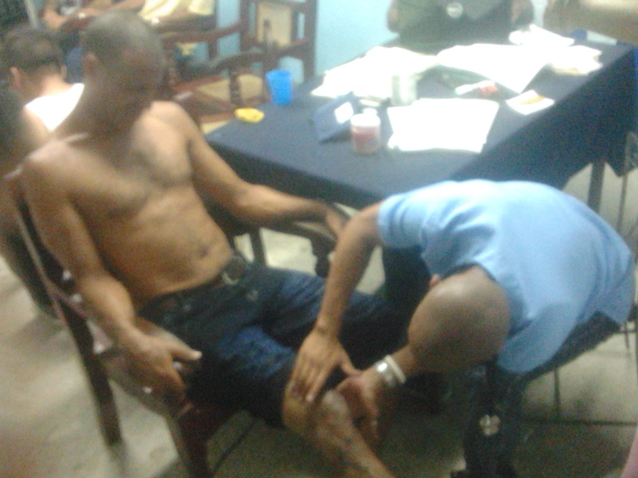 A doctor attends to Roberto Formigo, a UNPACU activist, after being assaulted by police.
