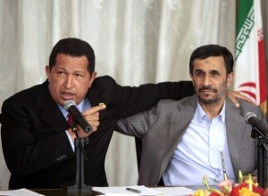 Venezuela's President Chavez speaks next to Iran's President Ahmadinejad during an agreement-signing ceremony in Tehran