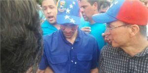 Former presidential candidate Henrique Capriles after being attacked with pepper spray, on Wednesday, during a march to demand a Venezuelan recall referendum.