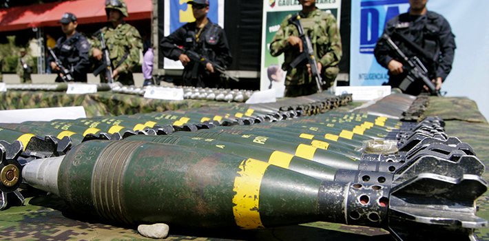 Soldiers guard mortars seized from FARC in a military raid near Medellín