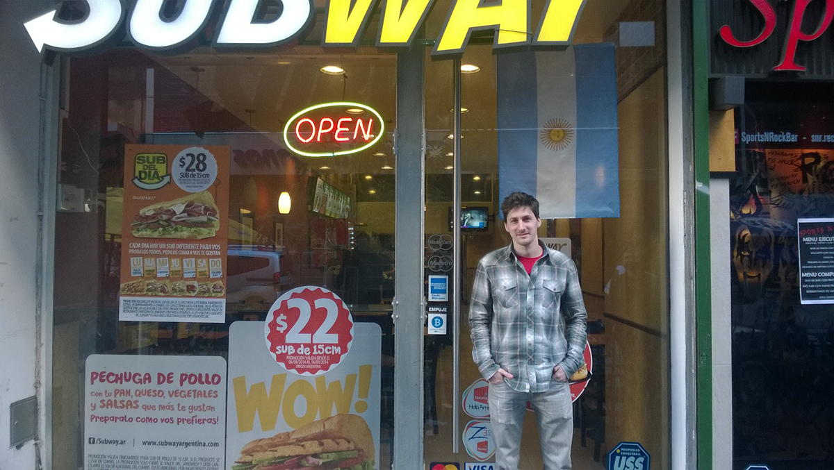 Fernando, the business owner now accepting bitcoins, in front of the entrance of one of his two Subway restaurants in Buenos Aires.