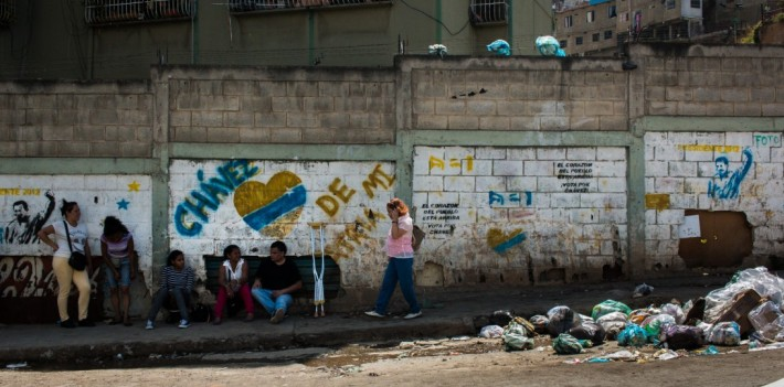 In a poverty-ridden Venezuela, Chavistas use the image of Hugo Chávez in an attempt to avoid a historic defeat in Sunday's election.