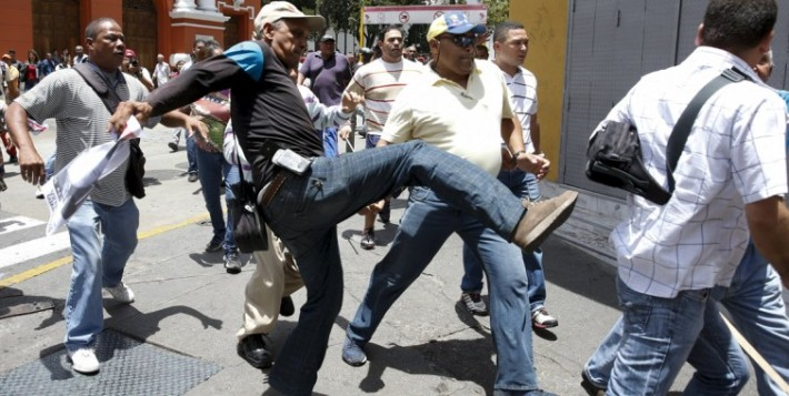 Pro-government activists attacked Leopoldo Lopez's supporters as they waited for the sentence to be announced.