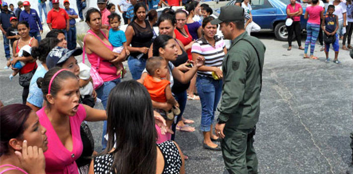 Venezuelan military personnel often give parents with young children priority in long lines for basic goods.