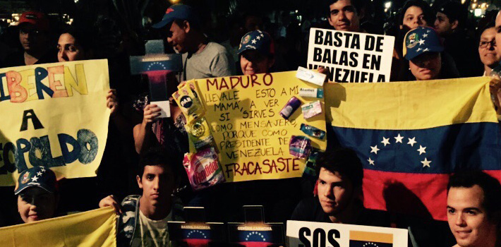 Venezuelans demand the defense of human rights in their home country in a protest outside the Summit of the Americas in Panama on Wednesday.