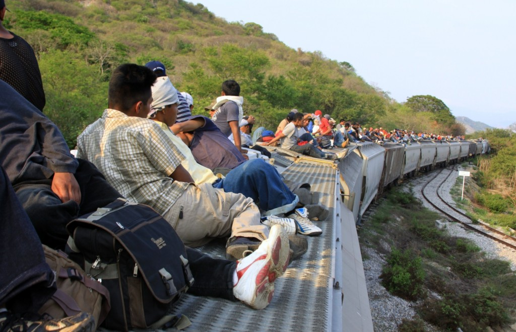 Immigrants traveling atop the train known as La Bestia