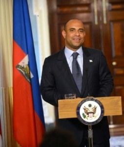 Lamothe had been under strong pressure to step down since protests in Haiti began.