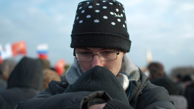 A young Russian prays during a demonstration held in honor of Boris Nemtsov in Moscow.