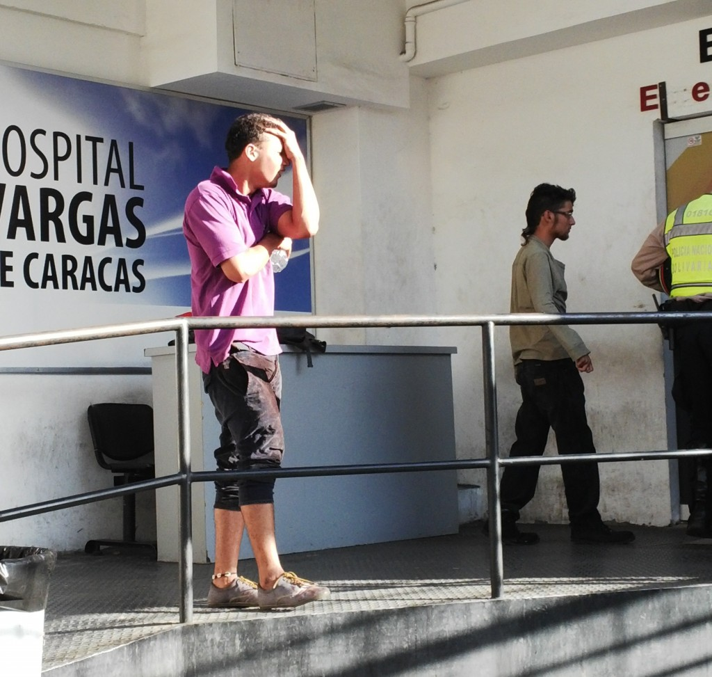 A cousin of Bassil Dacosta is informed of his death from a gunshot wound at Caracas's José María Vargas Hospital in Venezuela (Thabata Molina).