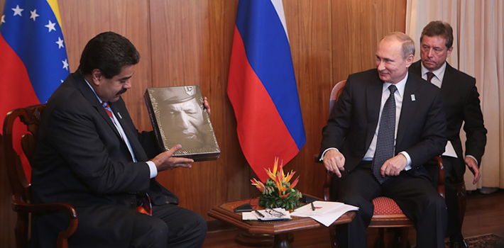 President Maduro presents Vladimir Putin with a gift to remember former President Hugo Chávez.