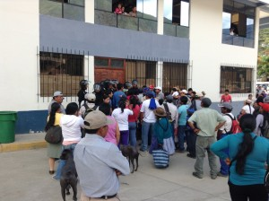 Villagers of Santa Teresa, Peru, attempt to enter the meeting with Luz del Sur in December 2014. (Scott Paton)