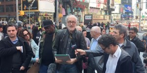 Hans Haacke, while reading the manifesto for Tania Bruguera in Times Square (Twinesocial)