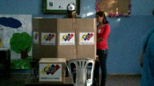 "Chavistas poll watchers use the ""assisted vote"" to compel voters in front of the voting machine to choose the ruling-party candidate."